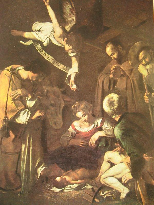 Nativity with St. Francis and St. Lawrence - Caravaggio