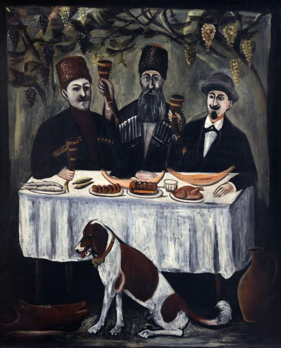 The feast in a grape gazebo  - Niko Pirosmani