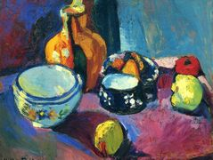 Dishes and Fruit on a Red and Black Carpet – Henri Matisse